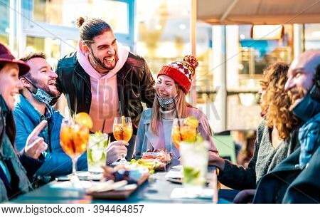 Friends Drinking Cocktails At Bar Restaurant Outside - New Normal Nightlife Concept With Happy Peopl