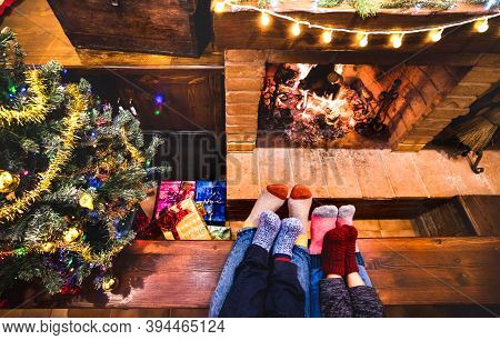 Mother Father And Kids Sitting At Cosy Fireplace On Winter Time - Lovely Family Resting Together On