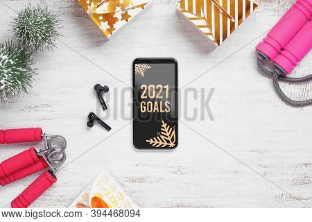 2021 New Year Resolutions  Healthy Goals Background Concept. 2021 Goals Text On Mobile Phone On Tabl