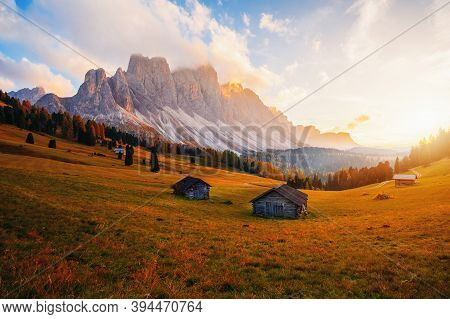 Beautiful Autumn Colors At The Foot Of The Odle Mountains In The Backdrop Of The Seceda Mountains At