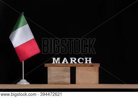 Wooden Calendar Of March With Italian Flag On Black Background. Dates In Italy In March.