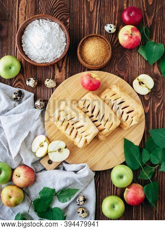 Top View Food Photography. Baked Puff Pastry Crispy Apple Puff With Ingredients On A Rustic Wooden T