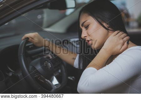 Beautiful Young Woman Rubbing Her Neck, Feeling Sore After Long Drive. Female Driver Having Terrible