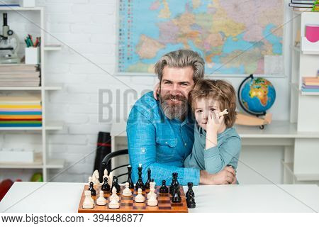 Kid Playing Chess. Teacher And Child. Fathers Day. Like Chess Game. Dad With His Child Son Are Playi