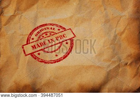 Made In Prc Stamp Printed On Crumpled Sheet Of Burnt Paper. Prc Product Business, Parcel, Package, P