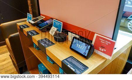 Seattle, Wa/usa-9/15/19: An Amazon Kindle Paperwhite, Fire, Alexa Echo Dot, And Echo Show 5 For Sale