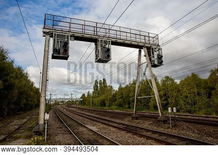 A Row Of Overhead And Gantry Railway Signals That Control The Movement Of Trains