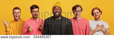 Optimistic Five Best Male Friends Have Happy Faces, Make Rock N Roll Gestture, Points Straightly At