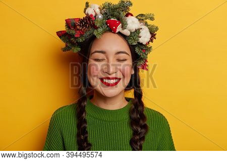 Portrait Of Joyful Girl Has Two Combed Plaits, Smiles Broadly, Shows White Teeth, Has Red Lips, Dres