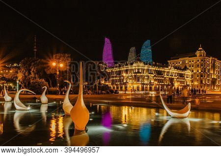 Baku,azerbaijan-june 26,2019.view Of Night City With Flame Towers. Long Exposure Lights. Night City
