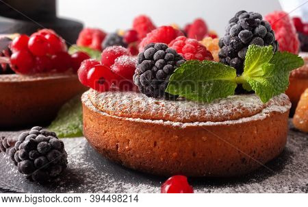 Fresh Small Homemade Fruit Tarts With Raspberries, Currants And Blackberries