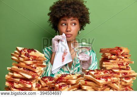 Aristocratic Lady In Elegant Outfit, Cleans Mouth With Napkin, Enjoys Cocktail, Poses In Restaurant,