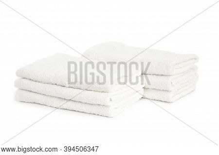Several White Beach Cotton Towels Folded On White Background