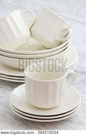 White Porcelain Dinnerware Set With Classic Rimmed Design Perfect Image For Your Next Project.