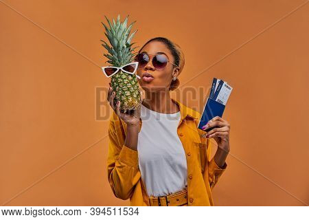 Happy Lady With Sunglasses With A Pineapple In White Sunglasses With A Passport With Tickets.