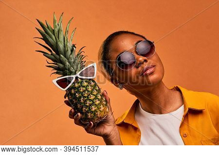 Happy Lady With Sunglasses With Earrings With A Pineapple In White Sunglasses.