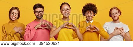 Horizontal Shot Of Happy Women And Men Show Heart Gesture, Express Love, Say Be My Valentine, Keep H