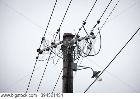 Old Power Electric Line And A Street Lamp, With A Power Supply Cable, Made Of An Obsolete Connection