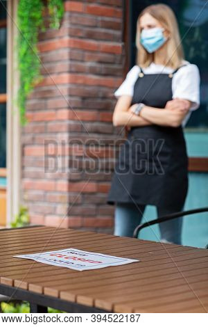 Caucasian Waitress Woman Wearing Medical Mask And Sorry Were Closed. Coronavirus Pandemic. Governmen