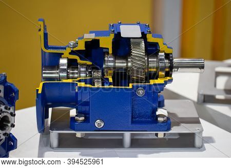 Cut-away Show Cross Section Internal Part Of Helical Bevel Gear Reducers. Industrial Gearbox
