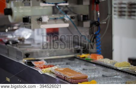 Processing Of Packaging Of Meat Ball And Sausage On Food Vacuum Packaging Sealing Machine In Food In