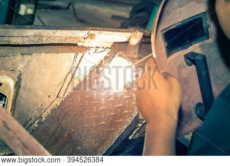 Welding Man Welding Car Mudguard Or Construction In Garage By Electrode Arc Welding Technique In Zoo