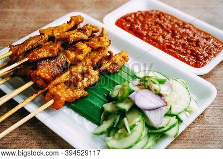 Close Up A Tasty Bbq Pork Satay Recipe Complete With A Peanut Satay Sauce And Cucumber Sauce, Onion,