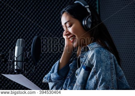 Happy Cheerful Pretty Smiling Of Portrait Of Young Asian Woman Vocalist Wearing Headphones Recording