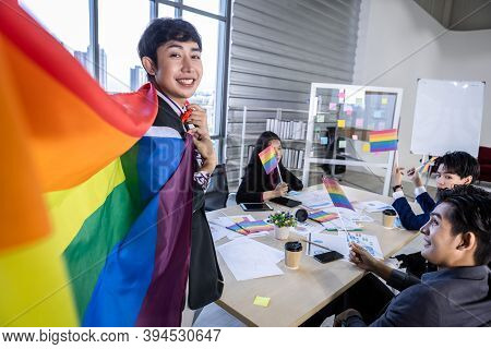 Homosexual Asian Businessman With Lgbt Flag And Successful Happy Workers With In Company  Workers Gr