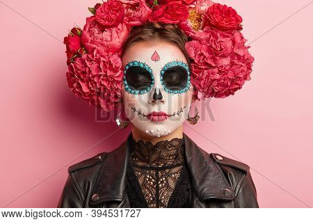 Close Up Portrait Of Beautiful Woman With Traditional Mexican Face Painting, Has Eyes Shut, Wears Wr