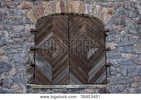 Wooden Door In A Stone Wall