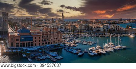 Beautiful Panoramic Aerial View Photo From Flying Drone At Sunset To Bari Apulia City Port Boats And