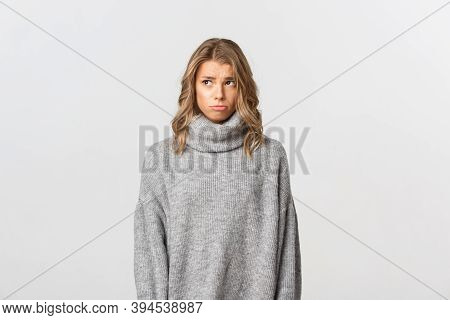 Image Of Upset Sulking Girl In Grey Sweater, Looking At Upper Left Corner Jealous Or Sad, Standing O