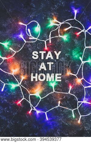 Holidays In Lockdown Due To Covid, Colorful Fairy Lights Surrounding Message About Staying At Home