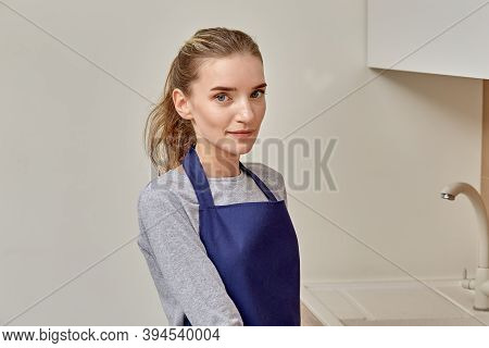 Portrait Of A Beautiful Young Woman Professional Cleaner In An Apron.
