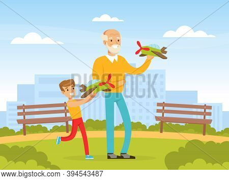 Grandpa And Grandson Playing With Toy Planes On Backyard, Grandfather Spending Time With Grandchild