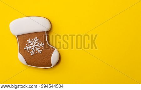 Christmas Stocking Shaped Gingerbread Cookie On Yellow Background, Top View. Space For Text