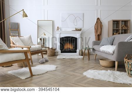 Beautiful Living Room Interior With Fireplace And Armchairs