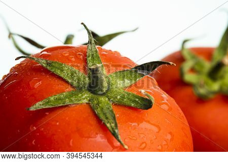 Macro Shot Of A Fresh Ripe Tomatos With Water Droplets