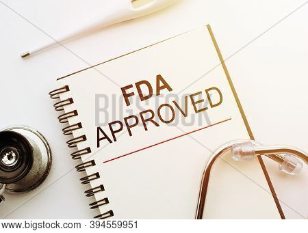 Fda - Food And Drug Administration Approved Text On Document Above Stethoscope. Healthcare Or Medica