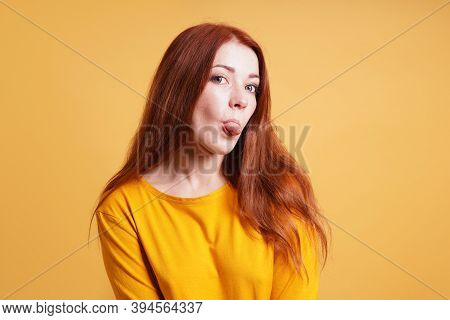 Cheeky Sassy Silly Young Woman Sticking Out Tongue