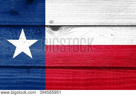 Texas Flag Painted On Old Wood Plank Background. Brushed Natural Light Knotted Wooden Board Texture.