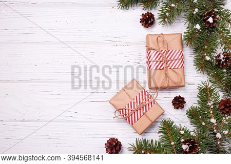 Christmas Greeting Card Concept. Gifts Box With Christmas Tree And Decoration On White Wooden Backgr