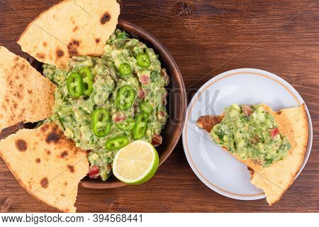 Homemade Guacamole - A Traditional Mexican Appetizer Of Avacado, Onion, And Tomato In A Bowl Of Toas