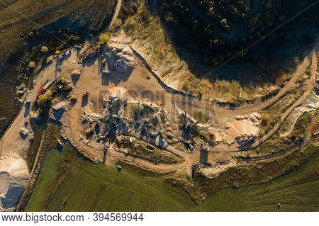Aerial Drone View Of Mining Quarry, Crushing Machinery, Processing Plant For Crushed Stone And Grave