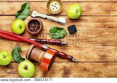 Smoking Hookah On Green Apple