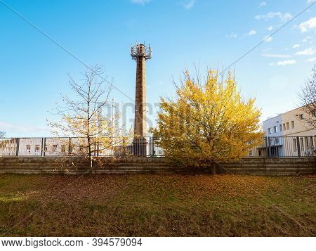 Covering City With Internet, 5g Networks And Telecommunication Services. Obsolete Chimney With Moder
