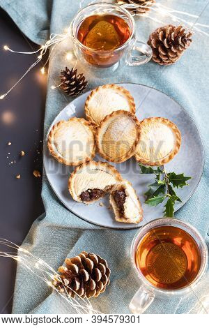 Mince Pies On A Plate Shot From Above. A Mince Pie Is A Traditional Christmas Sweet Pie, Filled With