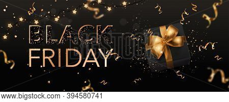 Black Friday Text Lettering On Dark Background With Black Gift Box, Golden Ribbons, Decoration, Conf