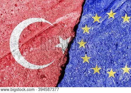 The Crack Between The European Union And Turkish Flags On The Concrete Wall. The Concept Of Sanction